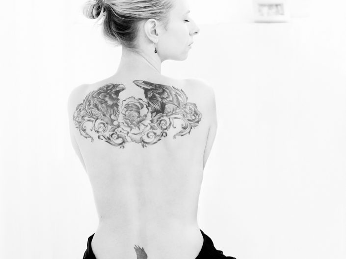 black and white picture of a woman with a tattoo