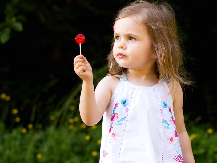 todler girl with a red lollipop