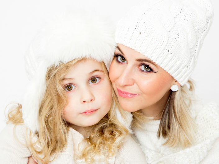 winter studio portrait of a mom and a daughter